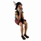 Statuette Pinocchio assis - rebord étagère